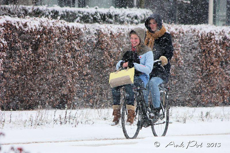 girls on bike in snow