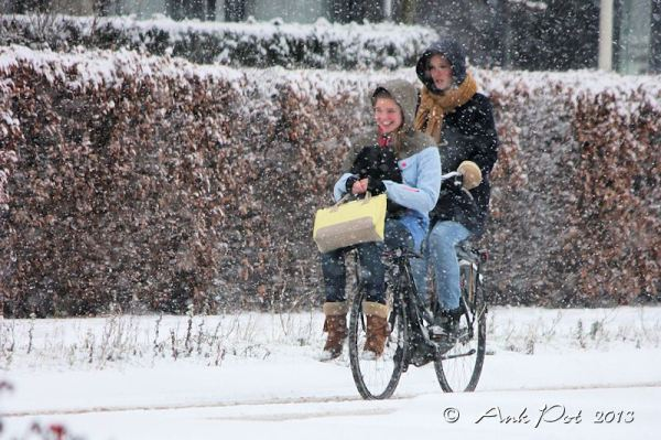 girls on bike in snow