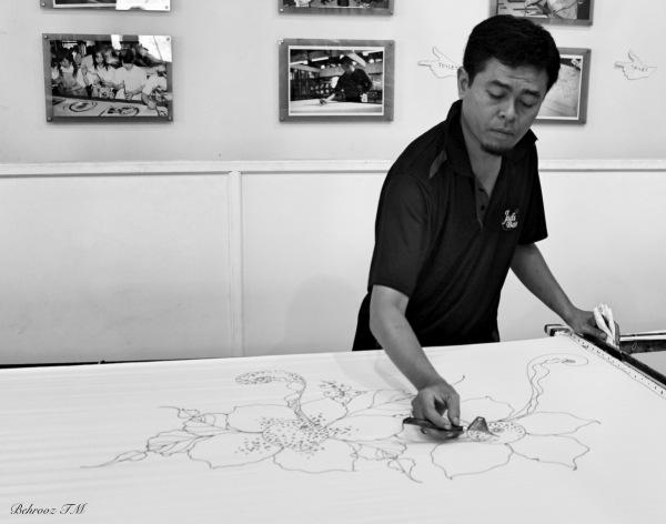 an artist making Batik in Kuala Lampur