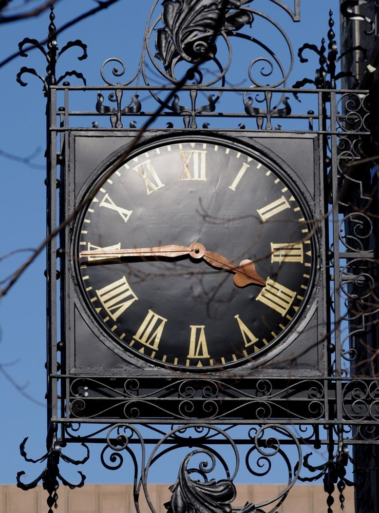 A gorgeous clock attached to an old church