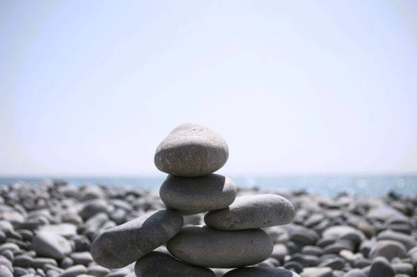 a small Inukshuk built on the  beach at Nice