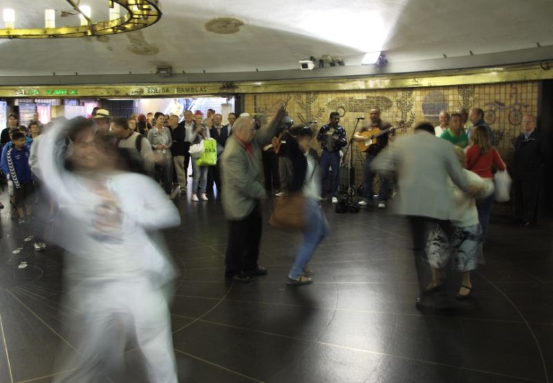 People stop to dance to the music in metro station