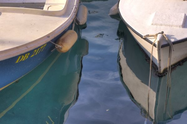 Reflection of boats in the old port of Dubrovnik