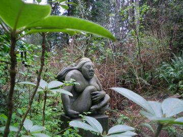 sculpture of woman in garden