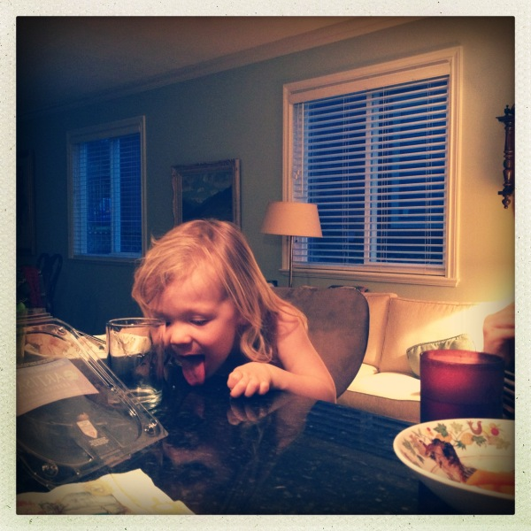 little girl finishing dinner