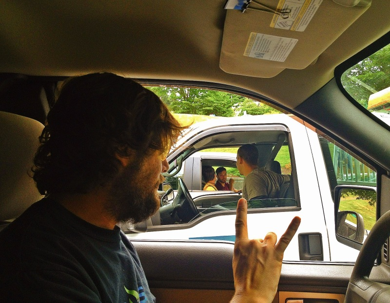 gand of dudes in a car