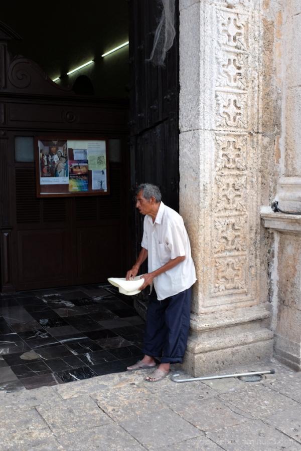 Church Door, Hat in Hand