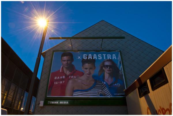 gaanstra,night,blue hour,text,model,orange,blue