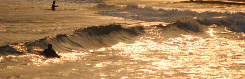 om beach, waves at sunset