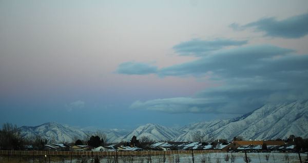 Cool pastel-colored sunset over snowy mountains UT