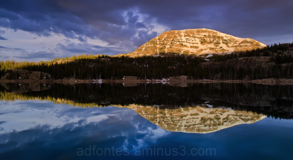 Mt. Watson in morning light reflected in Wall Lake