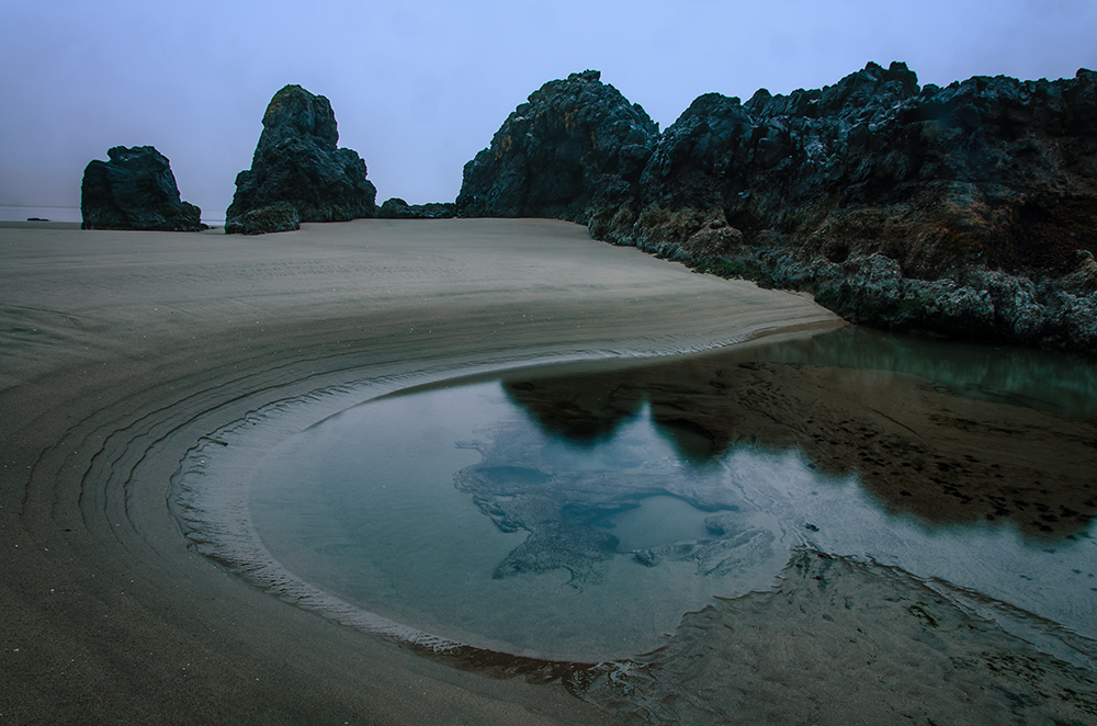 Tide pool and sea stacks at dawn in central Oregon