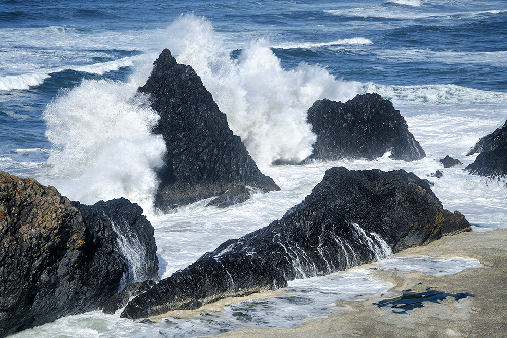 Incoming waves crash against sea stack (Seal Rock)