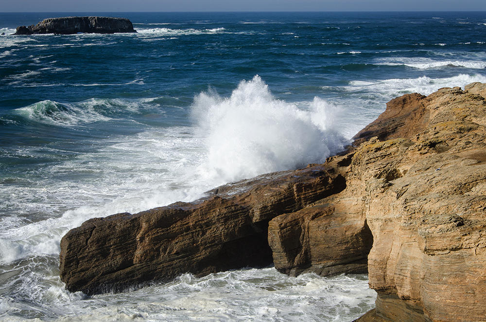 Waves crash against the cliffs of Devils Punchbowl