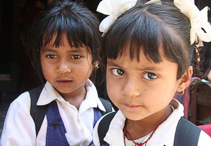 Portrait of two school girls in Nepal