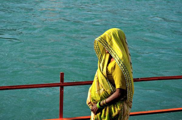 a veiled woman on the Ganga  bank Haridvar India