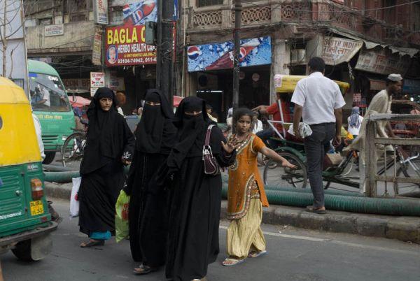 Muslims ladies crossing a street old Delhi India
