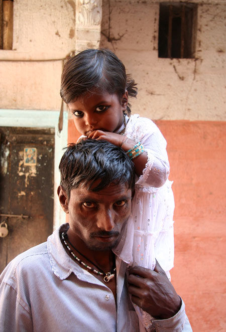 Girl on her father's shoulders