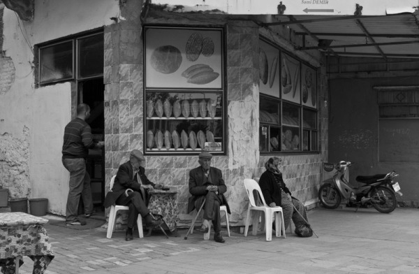 people sitting at the baker shop
