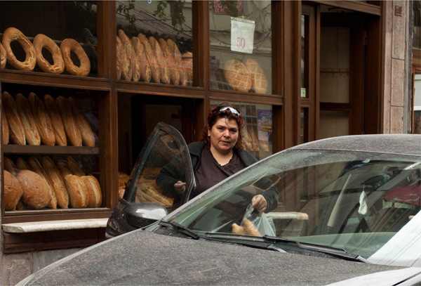woman going out of a bakery