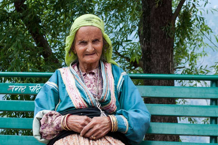 an old woman on a bench