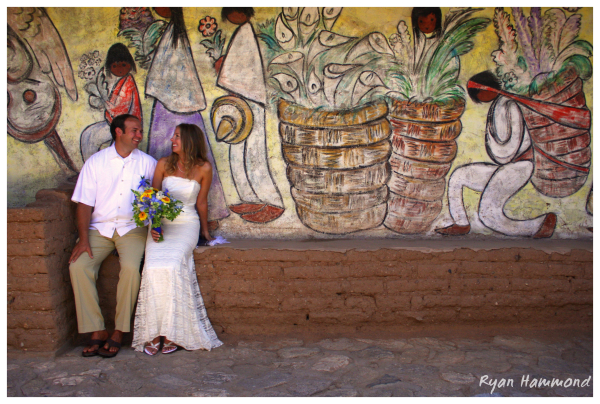 Newlywed couple sits in DeGrazia chapel
