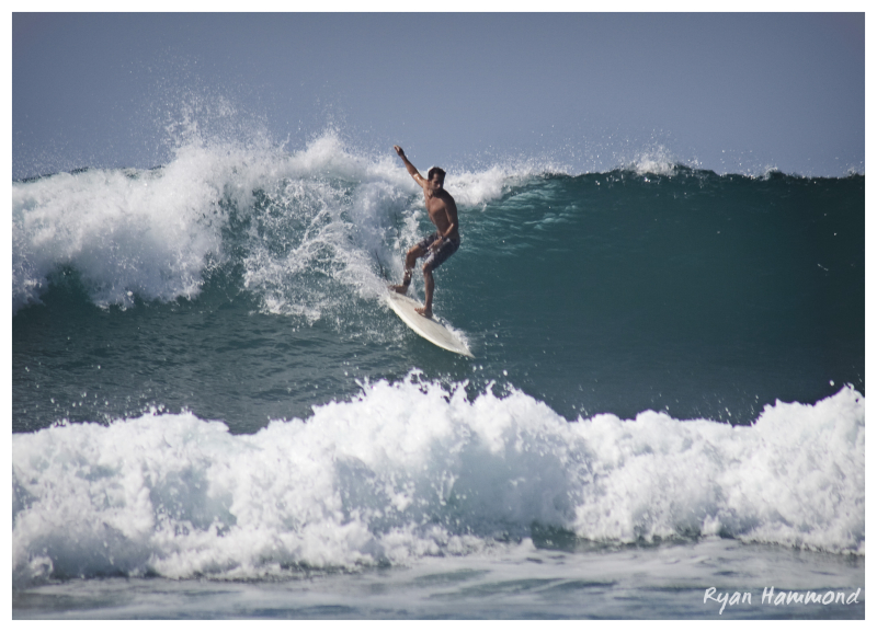 surfing a wave in Mexico
