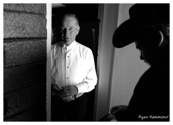 Older man gets ready for a old Western wedding