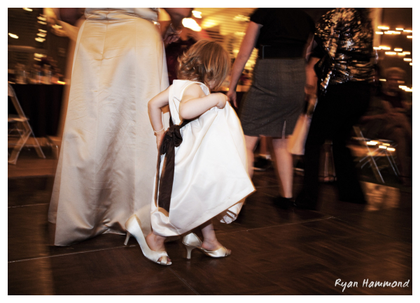 Little girl tries on Mom's heels.