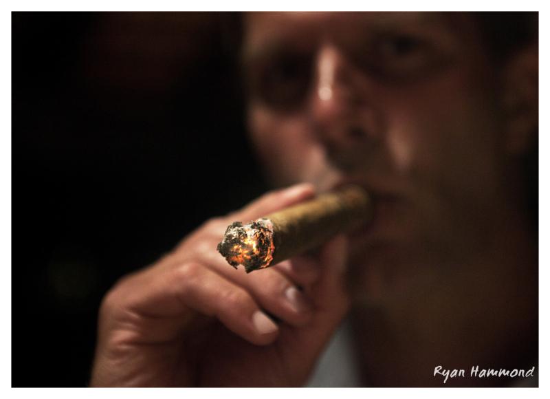 Man smokes his cigar