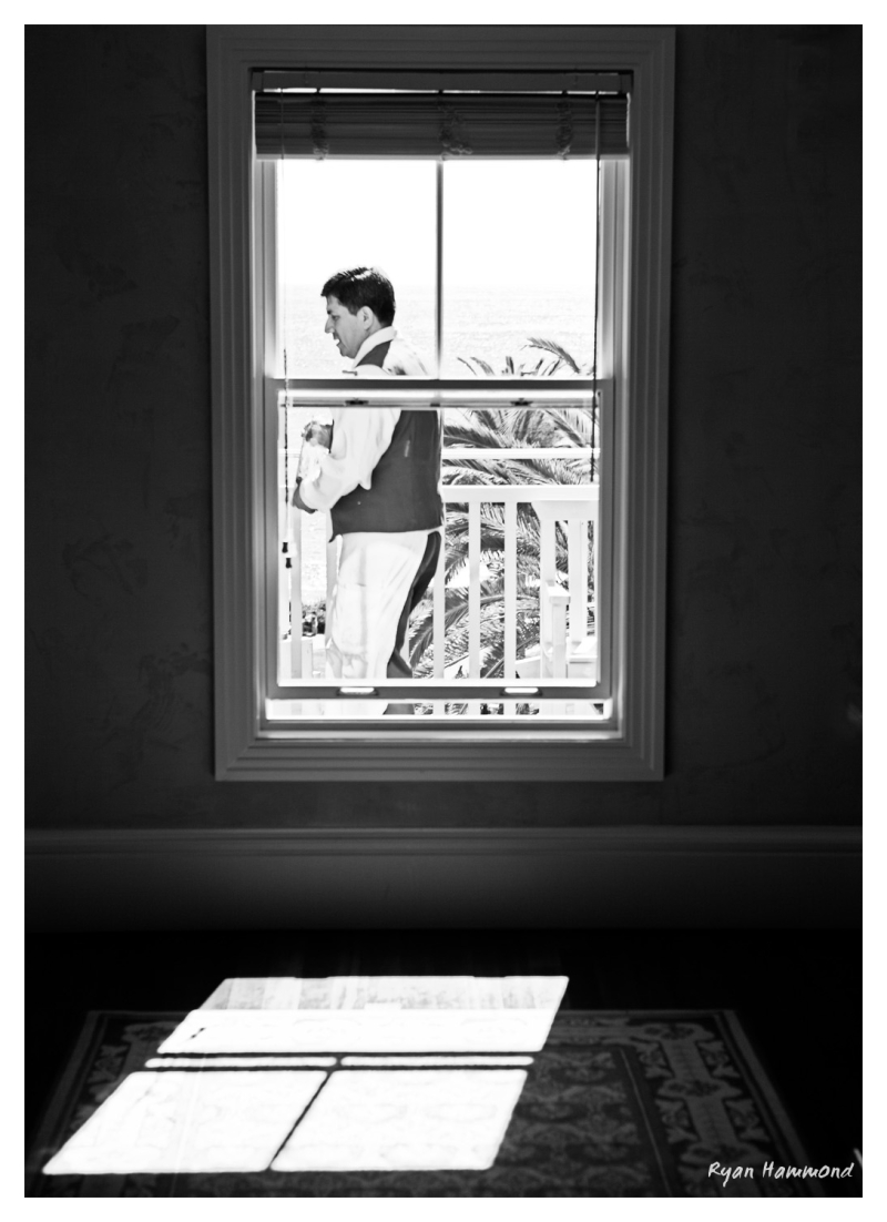 A waiter passes by a window