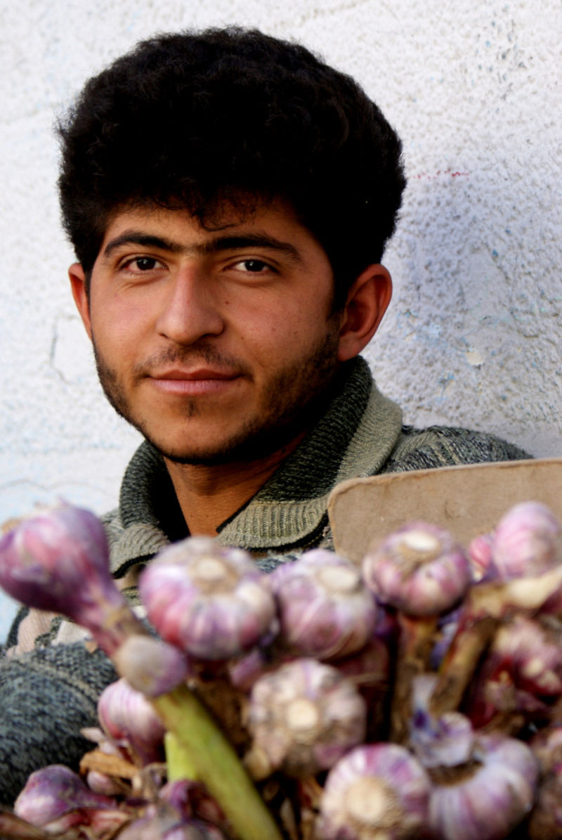 A young man vending garlic