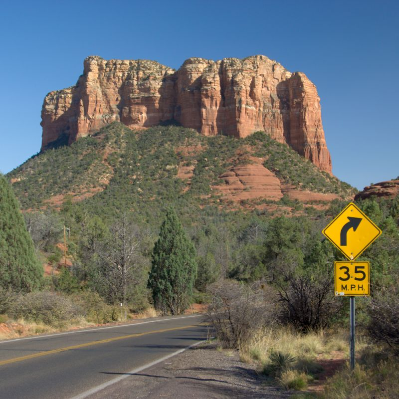 Road curves around a mesa near Sedona, Arizona