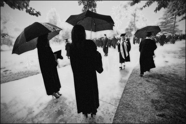 graduates in the rain