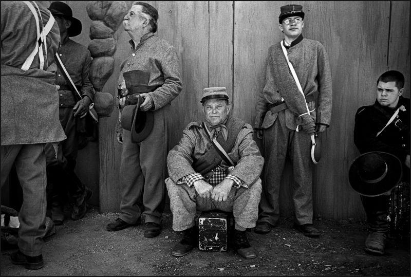 Civil War re-enactors wait to go into battle