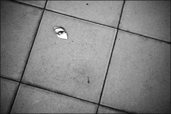 An eye in the sidewalk
