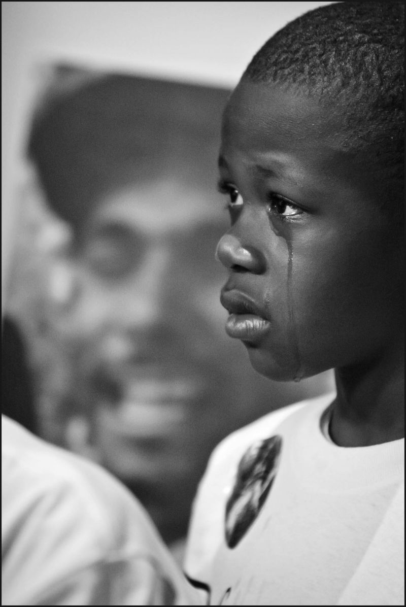 A boy mourns the loss of his father