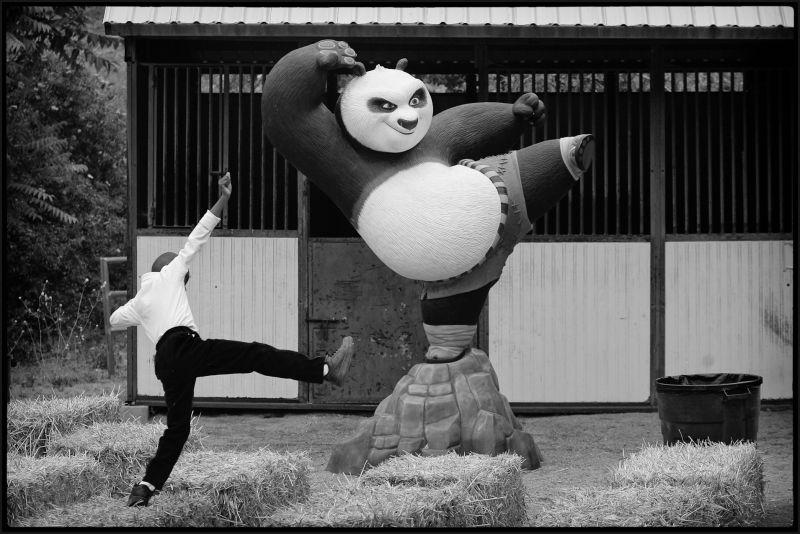 A boy makes like a panda