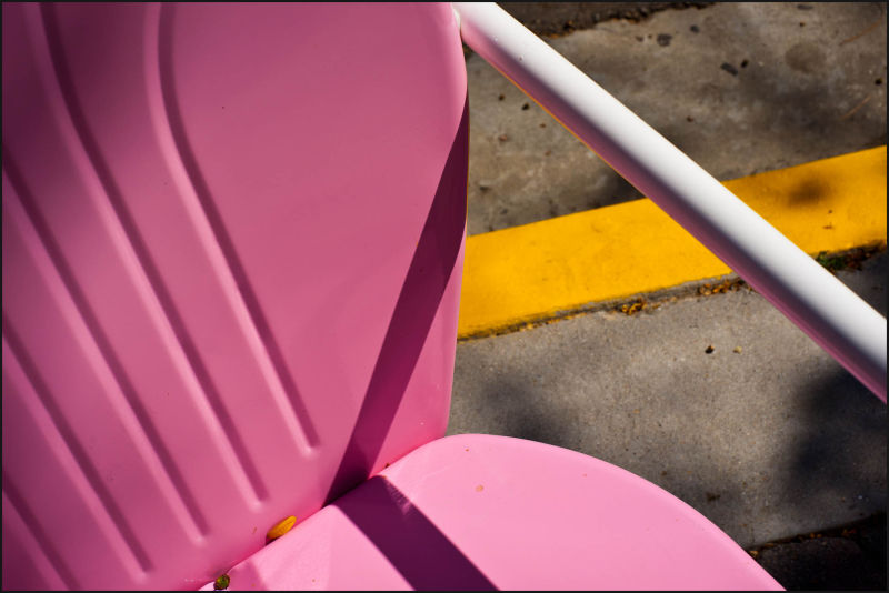 A pink lawn chair and a yellow line