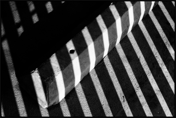 A curb in the sun