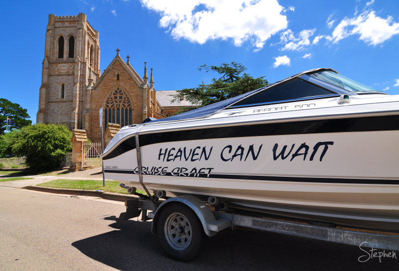 Outside a cathedral this boat has an ironic title