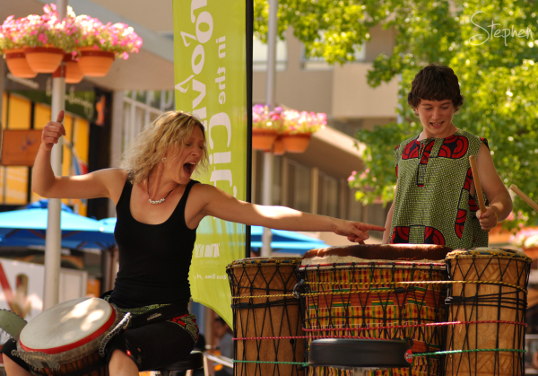 Kate Gascoyne playing the djembe with Drumassault