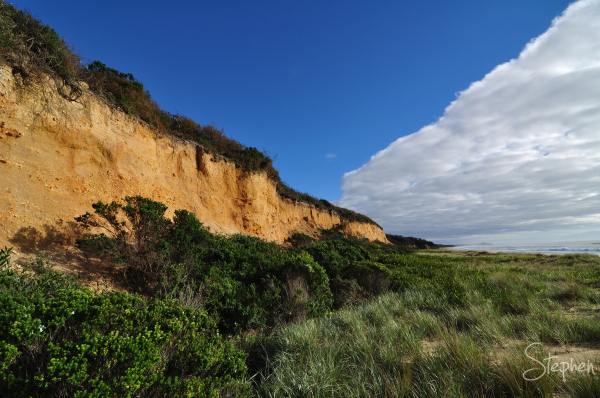 Colourful cliffs on the beach near Brou Lake