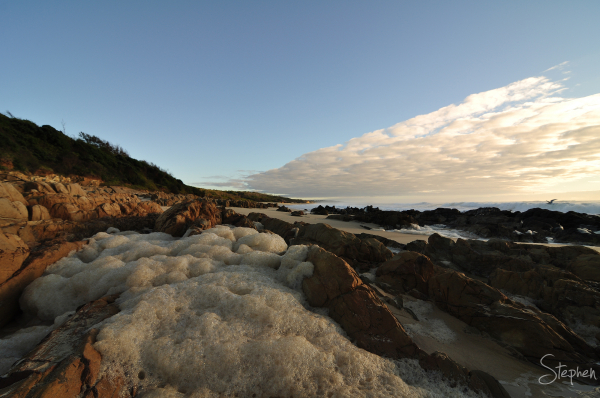 Sea foam on the beach near Brou Lake