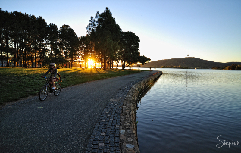 Cycling along the foreshore of Lake Burley Griffin