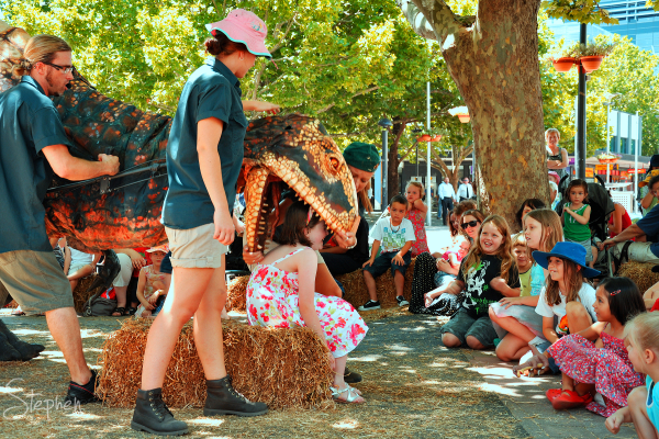 Dinosaur petting zoo in Canberra's Garema Place