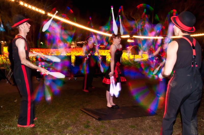 Cirquaholics juggling LED light pins at NightFest