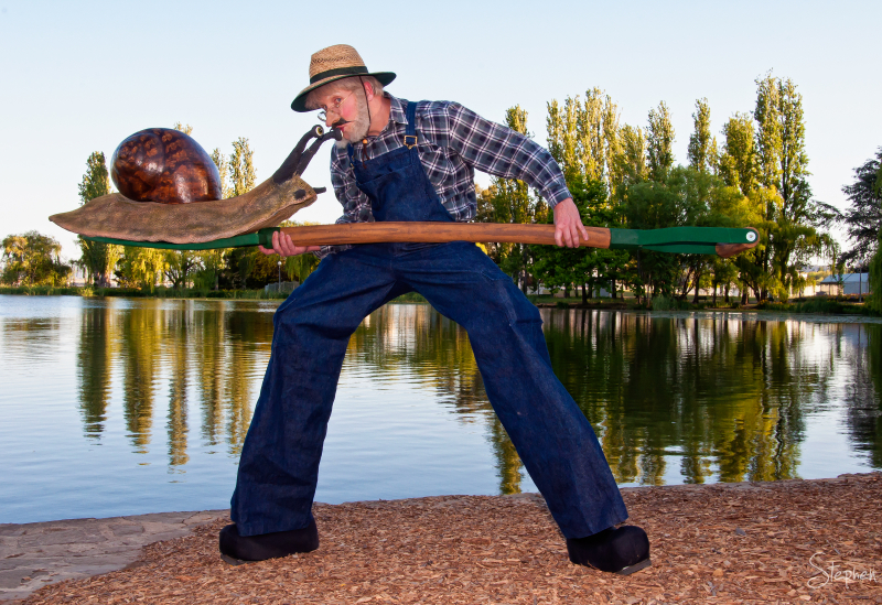 Neville the Gardener and giant snail at Floriade
