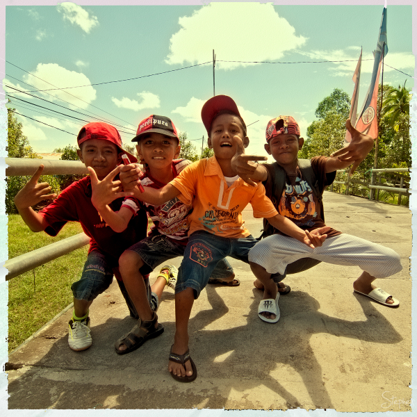 Young kids out together on the boardwalk in Agats.