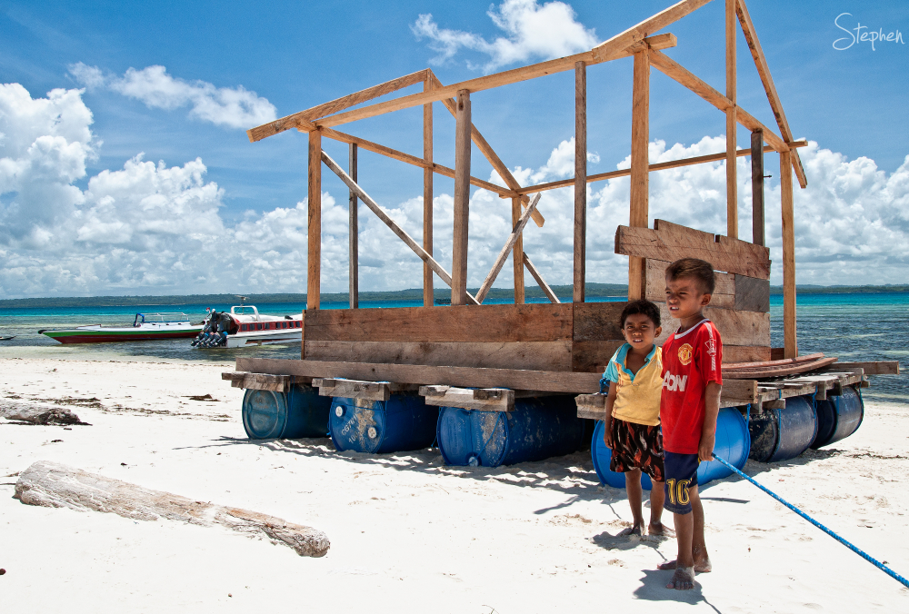 Boys with fishing platform on Yamdena Island